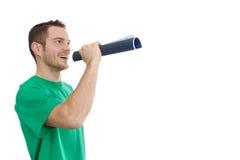 Mann im Grün mit dem Megaphon - Redner - lokalisiert auf Weiß Lizenzfreie Stockfotografie