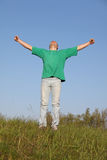 Mann im grünen T-Shirt Stockfotos