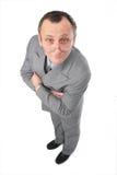 Mann im grauen Klageüberwachen Lizenzfreie Stockfotografie