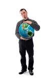 Mann im Hemd und Bindung, die Weltkugel hält Stockbilder