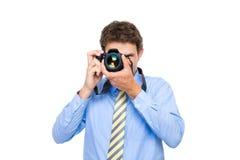 Mann im Hemd und in der Gleichheit nimmt Foto mit dslr Kamera Stockfotografie