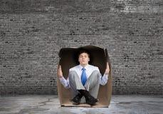 Mann im Kasten Stockfotos