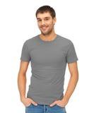 Mann im leeren grauen T-Shirt Stockbild