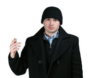 Mann im Mantel stockbild