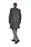 Mann im Mantel lizenzfreie stockbilder