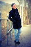 Mann im Mantel Stockbilder