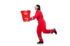 Mann im roten Overall Stockfoto