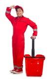 Mann im roten Overall Stockfotos