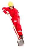 Mann im roten Overall Stockbilder