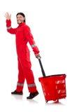 Mann im roten Overall Stockbild