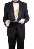 Mann im Smoking mit Champagne lizenzfreies stockfoto