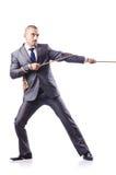 Mann im Tauziehenkonzept Lizenzfreies Stockfoto