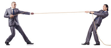 Mann im Tauziehenkonzept Lizenzfreies Stockbild