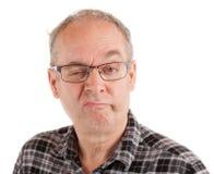 Mann ist über etwas skeptisch Lizenzfreie Stockbilder