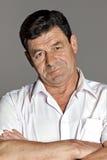 Mann 60 Jahre alte lächelnde Porträts Stockfoto