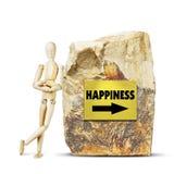 Mann lehnte sich an einem großen Felsen mit einem Pfeil zum Glück Stockbilder