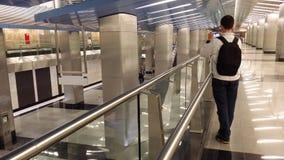 Mann machen ein Foto in der U-Bahn Stockfoto