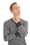 Mann mit Ausfragenaugen Stockbild