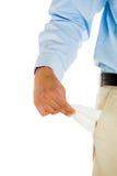 Mann mit Bindung, Khakis, Smokinghemd und dem Gurt, leere Tasche ausziehend stockbilder