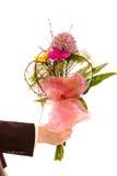 Mann mit Blumen lizenzfreie stockbilder
