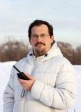 Mann mit Columbiumfunk Stockfoto