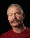 Mann mit dem buschigen Schnurrbart Stockfotos