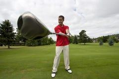 Mann mit dem Golfclub - horizontal lizenzfreies stockbild