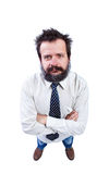 Mann mit dem lustigen Haar und buschigen dem Bart, die oben schaut Lizenzfreies Stockbild