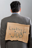 Mann mit dem Pappzeichen, das Job schaut Stockbild