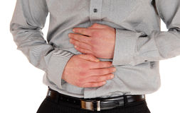 Mann mit den Magenschmerz Stockfotografie