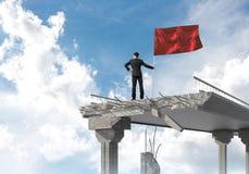 Mann mit der Flagge, die Führungskonzept darstellt Stockbild
