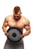 Mann mit der muskulösen Torsoaufstellung Stockbild