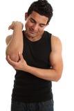Mann mit der Verletzung zusammenzuckend stockbilder