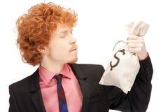 Mann mit Dollar gekennzeichnetem Beutel Stockfoto