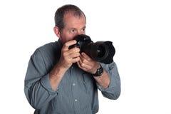 Mann mit DSLR Kamera auf weißem Hintergrund Stockfotos