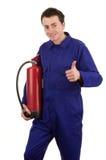 Mann mit einem Feuerlöscher Stockfoto