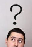Mann mit einem Fragezeichen Stockbilder