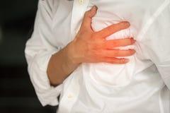 Mann mit einem Herzinfarkt Lizenzfreies Stockbild