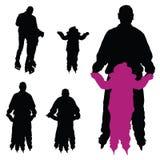 Mann mit einem Kind auf Rochen vector Schattenbild Stockfotos