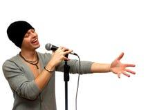Mann mit einem Mikrofon über weißem Hintergrund Lizenzfreie Stockbilder