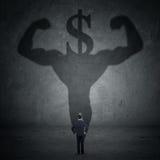 Mann mit einem Schatten des Athleten- und Dollarzeichens Lizenzfreie Stockfotos