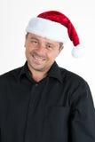 Mann mit einem Weihnachtshut Lizenzfreie Stockfotos