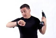 Mann mit einer Bohrgerätmaschine Stockfotografie