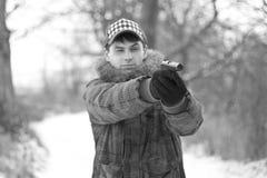 Mann mit einer Gewehr Stockbild