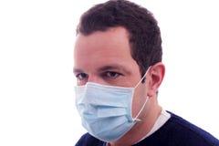 Mann mit einer medizinischen Schablone Lizenzfreies Stockfoto