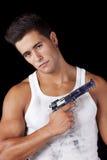 Mann mit einer Pistole lizenzfreie stockfotografie