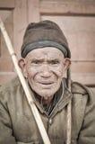 Mann mit gebräuntem Gesicht in Arunachal Pradesh Lizenzfreie Stockfotografie