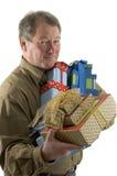 Mann mit Geschenkgeschenken stockbilder