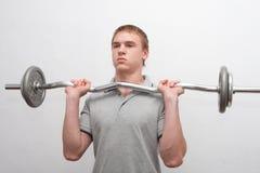 Mann mit Gewichtstab Stockfotos