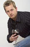 Mann mit Glas Wein Stockfoto